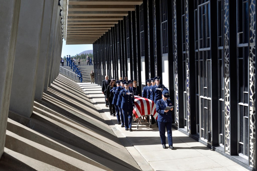 The casket containing the remains of Capt. Richard D. Chorlins killed in Vietnam War being laid to rest at the Academy Cemetery 45 years after his death on April 14, 2015. (U.S. Air Force photo/Liz Copan)