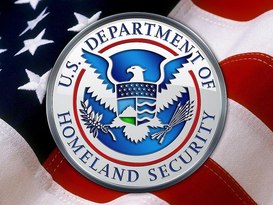 635501902302941305-department-of-homeland-security-dhs-emblem-over-american-flag-serge-averbukh