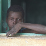 Boy_looking_out_of_the_window_in_South_Sudan